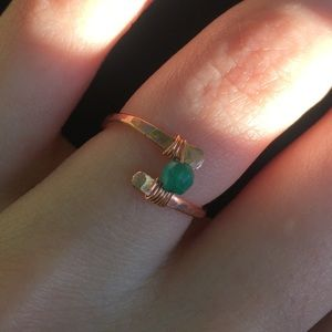 Tiny copper ring with green stone and wire design